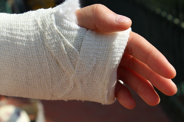 an injured hand covered with bandage