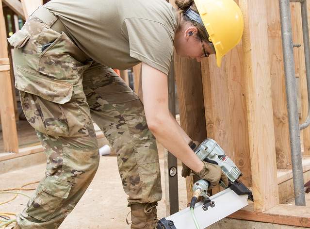 Woman using nail gun