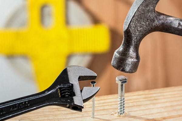 grey metal hammer and brad nails